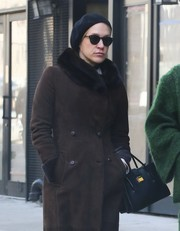 Chloe Sevigny finished off her outfit with a black wool beret.
