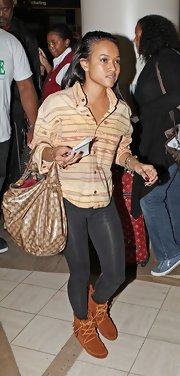 Karrueche Tran carried this large leather bag for her journey to the airport.