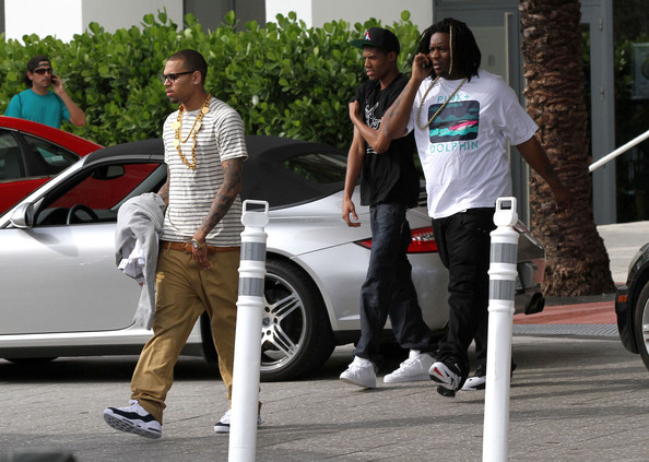Chris Brown got ready for a full day of walking around Miami in a pair of heavy duty basketball sneakers.