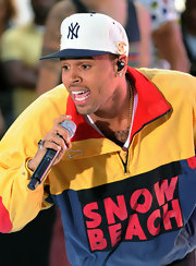Chris Brown gave an energetic performance to NBC's 'Today Show' audience while wearing a logo baseball cap.