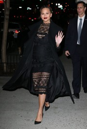 Chrissy Teigen enjoyed a night out looking ravishing in a black mesh dress by Asilio.