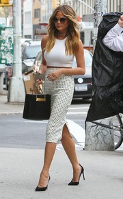 Chrissy Teigen wowed on the streets of New York City with this dotted pencil skirt and crop-top combo.
