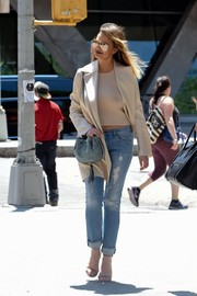 Chrissy Teigen was street-chic in ripped jeans and a satin coat while out and about in New York City.