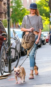 Chrissy Teigen looked cool and trendy in a gray and white striped crop-top while out walking her dog.