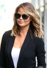 Chrissy Teigen was spotted out in New York City wearing a pair of Oliver Peoples cateye sunglasses.