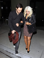 Christina Aguilera added some hippie flare to her saucy outfit with this fringed black bag.