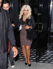 Christina Aguilera's snake print dress makes for the perfect night out attire.