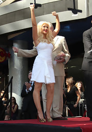 Christina Aguilera received her Hollywood star in style in leopard Christian Louboutin pumps. The songstress paired the heels with a white Marilyn Monroe inspired dress.