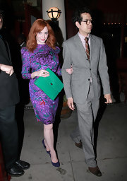 Christina Hendricks looked like a lovely vision from the '80s in this iridescent splatter-print dress while out with her husband.