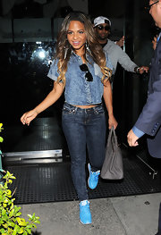Christina Milian was clearly feeling the blues, pairing these baby blue sneaks with her denim-on-denim look.