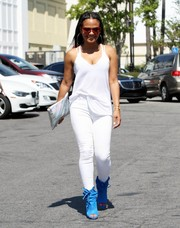 Christina Milian injected some color via a pair of electric-blue peep-toe boots.