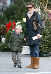 Even supermodels have to rest their feet! Christy Turlington picked her son up from school in well-loved sheepskin boots.
