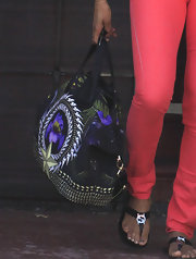 Ciara complemented her light coral look with a dark printed oversized bag.