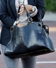 Putting her modeling days behind her, Cindy was seen out and about carrying a nice leather tote.