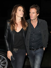 Cindy Crawford toughened her street style with a leather jacket and a matching T-shirt.