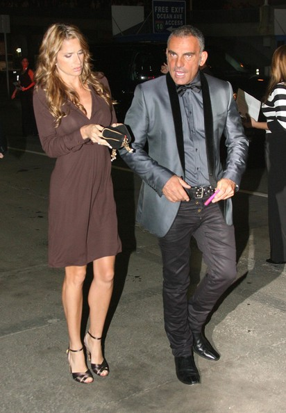 Christian wears a metallic men's suit jacket while out with his wife in Santa Monica.