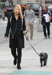 Claire Danes kept it low-key in a black wool coat and matching jeans while walking her dog.