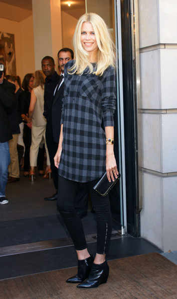 Claudia Schiffer pairs her casual plaid tunic and tights combo with these black leather wedge boots. She finishes off the look with a cuff bracelet and a simple black clutch.