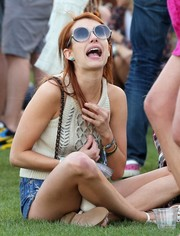 Emma Roberts lounged about during Coachella wearing oversized round sunnies by Jimmy Choo.
