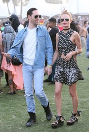 Kate Bosworth teamed her dress with chunky black platform sandals, also by Carven.