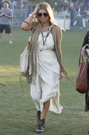 Fergie got her '70s on in this fringed beige vest at Coachella.
