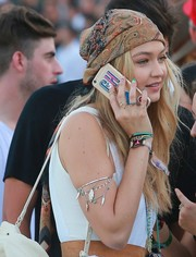 Gigi Hadid jazzed up her sleeveless outfit with an ASOS arm bracelet that was adorned with feather charms.