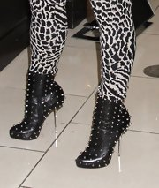 Coco amped up the edge factor with a pair of studded black boots with metal stiletto heels.