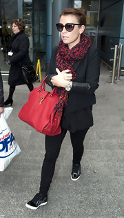 Coleen bundled up with a chic printed scarf and casual athletic kicks.