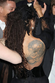 Wearing a backless dress, Lisa Bonet put her huge dragon tattoo on display during the premiere of 'Conan the Barbarian.'