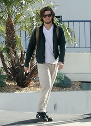 Alex Pettyfer chose a basic green zip-up for his look while out riding motorcycles with a friend.