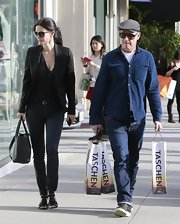 Courteney Cox showed her classic style with a black blazer paired over a simple black top.