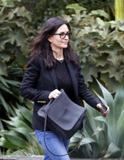 Courteney Cox headed out in West Hollywood carrying a classic black satchel.