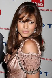 Eva Mendes showed off her sultry side while attending the DKMS' Annual Gala. Her side-swept bangs and darling earrings worked perfect with her Alberta Ferretti dress.
