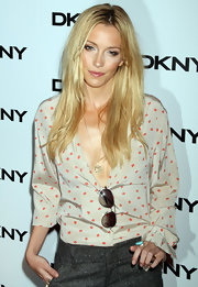 Katie Cassidy opted for a printed blouse paired with casual straight locks for the DKNY soiree in New York City.