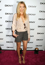 Katie Cassidy dressed up her polkadot blouse and tweed shorts at the DKNY Sunglass Soiree with a pair of blush peep-toes trimmed in gold. The girly Resort 2012 heels took the starlet's look from day to night.
