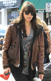 Daisy Lowe looked tough in this rugged brown leather jacket while walking her dog.
