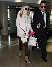 Dakota Fanning opted for tan suede boots.