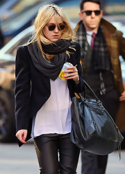 Dakota Fanning looked stylish beyond her years in this charcoal scarf and sleek blazer.
