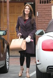 A sleek nude bag was a must for Lisa Vanderpump while heading into the 'Dancing With the Stars' rehearsals.