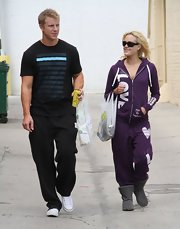 Peta Murgatroyd looked super comfy in a purple zip-up hoodie and matching sweatpants.