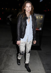 Daveigh Chase contrasted feminine with grungy, wearing a sheer powder blue blouse with ripped up skinny jeans.