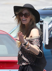 Delta Goodrem looked funky in her round sunnies as she headed to Capitol Records in Hollywood.