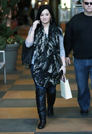 Demi Lovato went shopping in slouchy black leather over-the-knee boots.