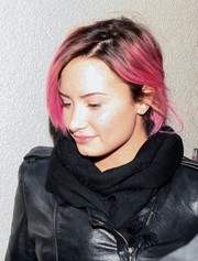 Demi Lovato stayed warm with a black Gucci scarf teamed with a leather jacket while catching a flight.