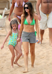 Denise Richards teamed her lime green bikini with gray jersey shorts. The perfect pair of shorts for a day at the beach!