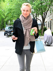 Diane Kruger tossed on this thick brown scarf with a slight fringe for her walk in NY.