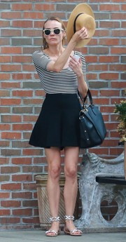 Diane Kruger teamed her top with a pair of flared black shorts.