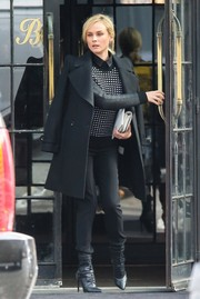 Diane Kruger stepped out in New York City looking flawlessly styled in a crisp black coat layered over a pattered sweater.