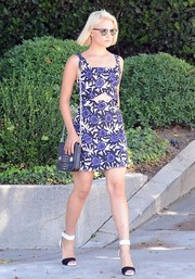 Dianna Agron teamed her dress with stylish black-and-white ankle-cuff sandals.