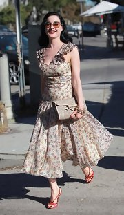 Dita Von Teese is the queen of retro style, so this elegant bow-bedecked clutch fit right in perfectly with her look.